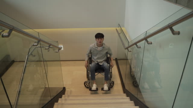 wheelchair user cannot go up the staircases - uncomfortable stock videos & royalty-free footage