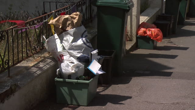 Wheelie bin and overflowing recycling box in a street in Brighton, UK