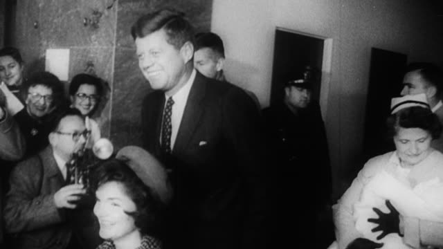 jfk wheeling wife out of georgetown university hospital after the birth of their son john f kennedy jr / john f kennedy jr is born and leaves... - anno 1960 video stock e b–roll