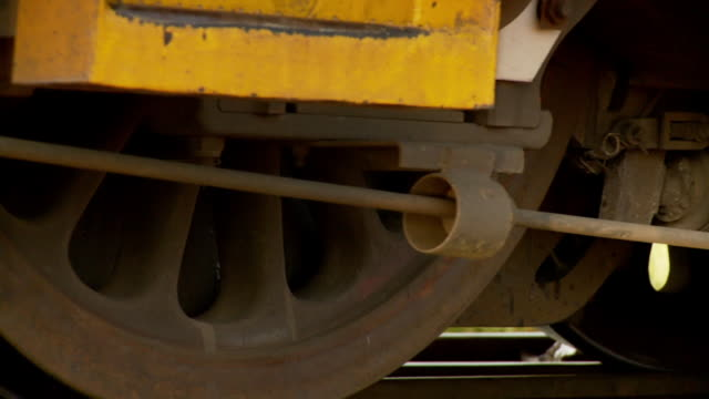 stockvideo's en b-roll-footage met cu wheels moving of train / south africa - commercieel landvoertuig
