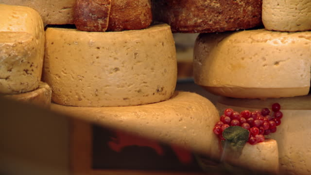 wheels of cheese on a tablet - medium group of objects stock videos & royalty-free footage