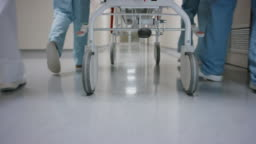 DS Wheels on the gurney being pushed down the hospital hallway