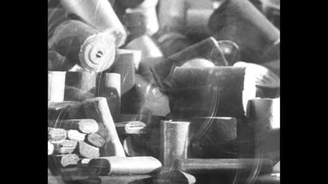 wheels spinning pulled by belts fading into panning shot of different items superimposed over spinning wheels fading into coins spilling down into... - incomplete stock videos and b-roll footage