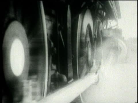 wheels turn on a locomotive - 1932年点の映像素材/bロール