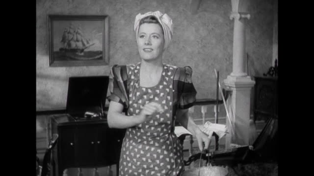 1941 When caught dancing by a disapproving woman, woman (Irene Dunne) gets flustered