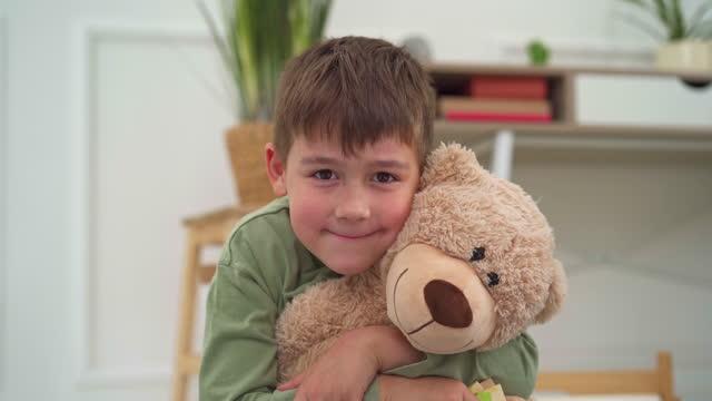 when he felt overwhelmed, he always hugs his favourite teddy bear - teddy bear stock videos & royalty-free footage