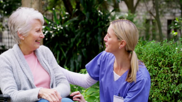 when her patient's are happy, she's happy - nurse walking stock videos & royalty-free footage