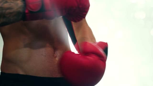 when life gets tough, put on your boxing gloves! - glove video stock e b–roll