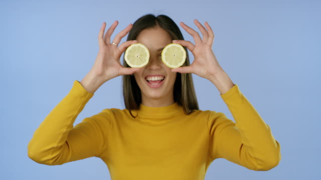 when life gives you lemons... - young women stock videos & royalty-free footage