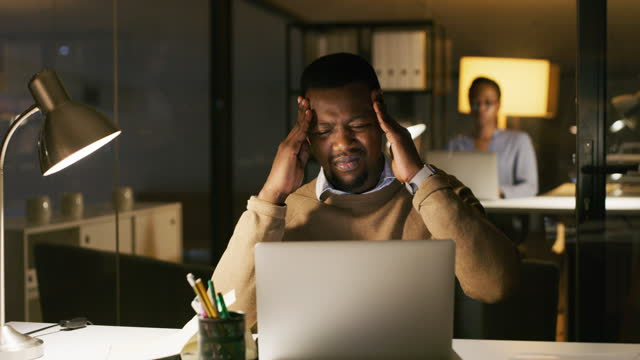 when the night shift starts turning into a nightmare - headache stock videos & royalty-free footage