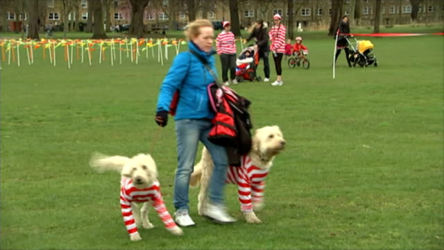 where's wally fun run to raise money for the national literacy trust england london hackney victoria park ext various of charity runners dressed in... - victoria park london stock videos & royalty-free footage