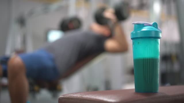 whey protein shake in the gym - protein stock videos & royalty-free footage