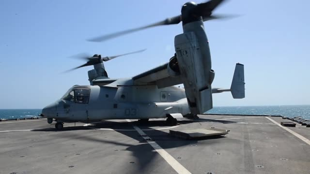 whidbey islandclass amphibious dock landing ship uss fort mchenry conducts flight operations while operating in the persian gulf - fire extinguisher stock videos & royalty-free footage