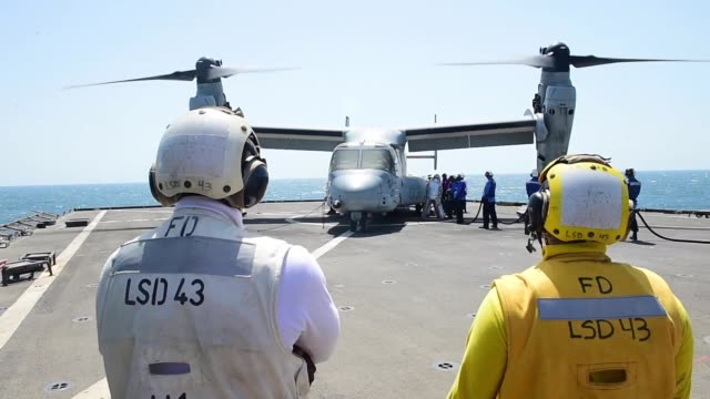whidbey island-class amphibious dock landing ship uss fort mchenry conducts flight operations while operating in the persian gulf. - fire protection suit stock videos & royalty-free footage