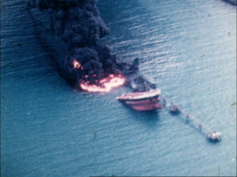 whiddy island disaster / betelgeuse incident tanker disaster report bantry bay whiddy island airv burning ship zoom in tx 8179 airv ditto col pull... - back lit stock-videos und b-roll-filmmaterial