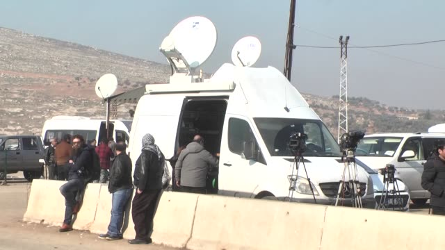 while civilians evacuation from war-battered aleppo continue, 120 local and international journalist folllow the ceasefire and evacuation operations... - shi'ite islam stock videos & royalty-free footage