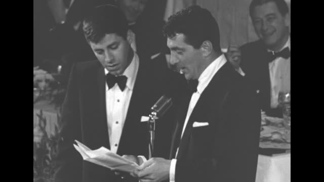 SOT while Dean Martin reads an acceptance speech Jerry Lewis reads along but is stuck at 'We'