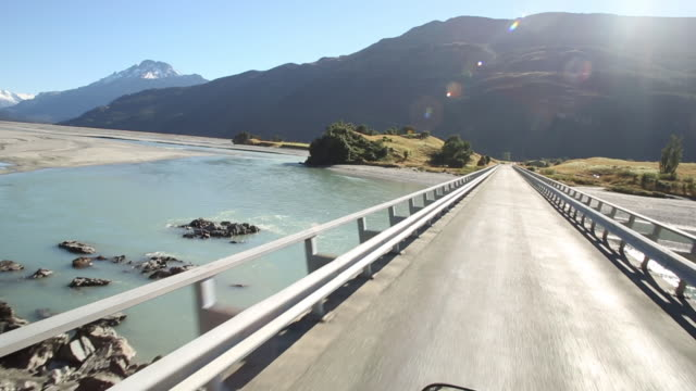 pov while driving along road past mountain ranges - mountain range stock videos & royalty-free footage