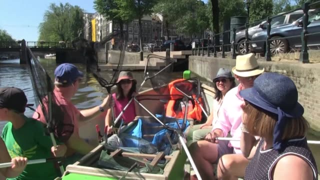 while eco tourism is booming around the world the dutch company plastic whale is offering a new style of cruises along amsterdam's famous canals - eco tourism video stock e b–roll