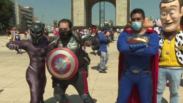 while in cinema and comics superheroes save cities from evil, in mexico city, street performers dressed as superman, captain american or even sheriff... - superman superhero stock videos & royalty-free footage