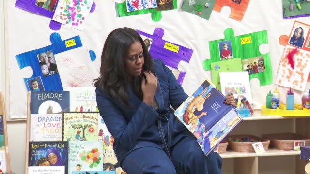 ktla while in los angeles for her book tour former first lady michelle obama spent a portion of thursday reading to preschool children at the para... - niños stock videos & royalty-free footage