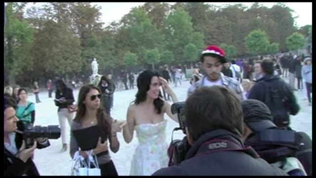 While in Paris for the ready to wear spring summer 2009 collections the American singersongwriter Katy Perry and her boyfriend Travis McCoy stopped...