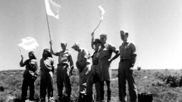 stockvideo's en b-roll-footage met while irgun forces hail return of menachem begin the underground chief who eluded the british a united nations truce team accompanies haganah group... - 1948