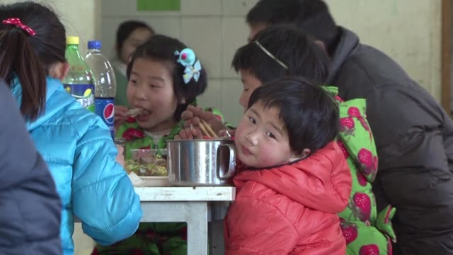 while millions of chinese return home to their families for the lunar new year holiday children in a small beijing orphanage spend the holiday... - orphanage stock videos and b-roll footage