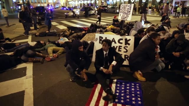 while on their way to the white house, they lay down at the intersection of 14th and f streets, nw, to block the traffic. november 25 washington, dc.... - reclining stock videos & royalty-free footage