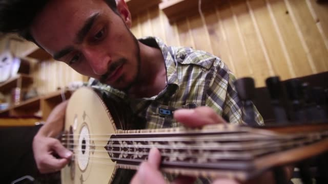 While the conflict that has ravaged Syria over the past six years has devastated many of its historic crafts the production of the oud the oriental...