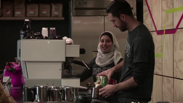 while the controversy surrounding president trump's immigration ban rages a coffee shop in california is hiring refugee baristas - recruitment stock videos & royalty-free footage