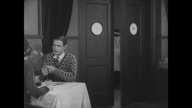 1927 while waiting tables incognito, man (buster keaton) has a tense exchange with a dinner patron - buster keaton stock videos and b-roll footage