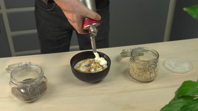 whipped cream topping on yogurt dessert - maple syrup stock videos & royalty-free footage