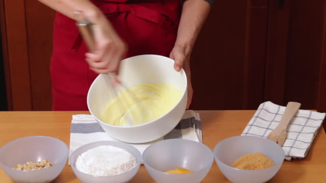 whipping butter in a bowl - wire whisk stock videos and b-roll footage