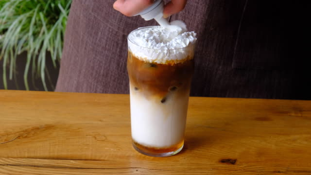 whipping cream on cold drink - whipped cream stock videos & royalty-free footage
