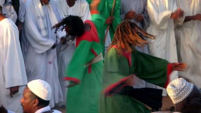 whirling dervishes spin and dance during a muslim religious ceremony in khartoum.  - celebration event stock videos & royalty-free footage