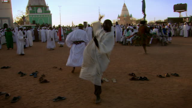 stockvideo's en b-roll-footage met whirling dervishes spin and dance during a muslim religious ceremony in khartoum.  - ceremonie
