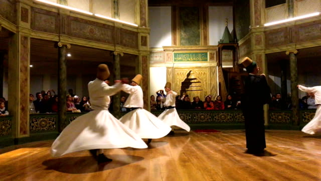 whirling dervishes take part in a sema prayer ceremony marking the anniversary of the death of mevlana jalal al-din al-rumi on december 17, 2017 in... - tourism stock videos & royalty-free footage