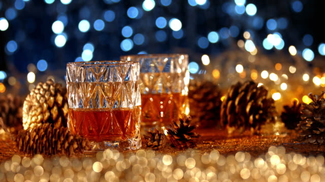 whiskey in christmas decorations - bar background stock videos & royalty-free footage