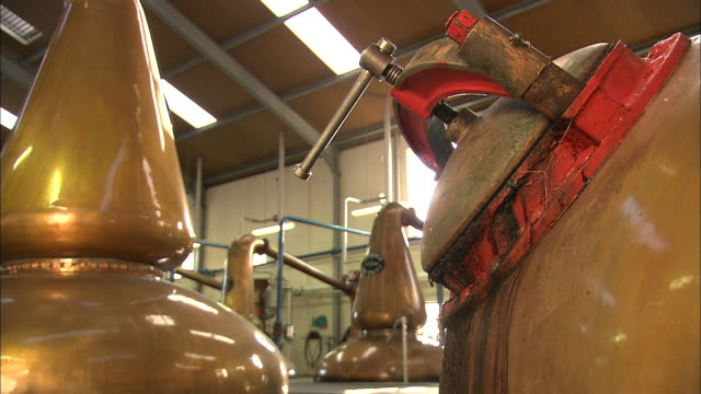 whiskey is distilled in a scottish factory. - distillery still stock videos & royalty-free footage