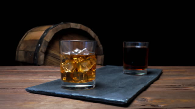 whiskey on bar counter - whiskey stock videos and b-roll footage