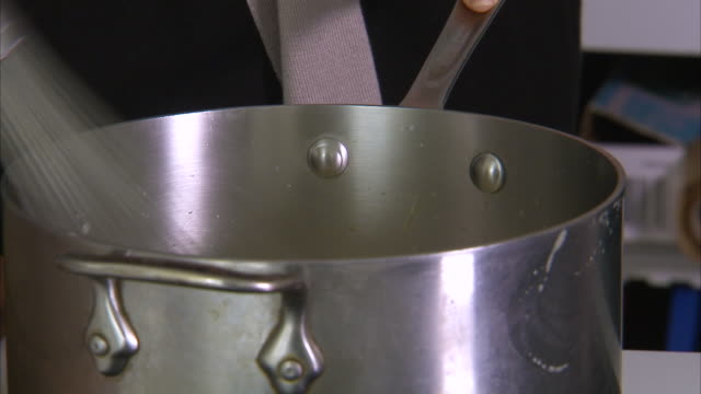 whisking on a stainless casserole - wire whisk stock videos and b-roll footage