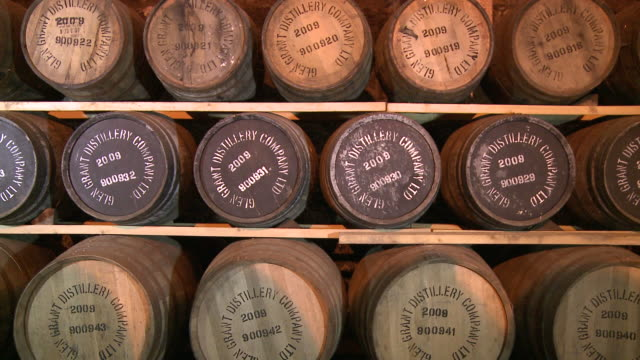ms whisky casks in warehouse / rothes, speyside, scotland - scozia video stock e b–roll