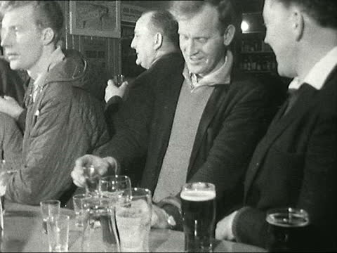 whisky industry in islay; scotland: inner hebrides: islay: men shovel barley turning it over to richard whiteley sof turning the floor pull out men... - refreshment stock videos & royalty-free footage