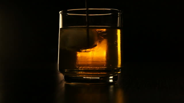 whisky on the rocks - stirring stock videos & royalty-free footage