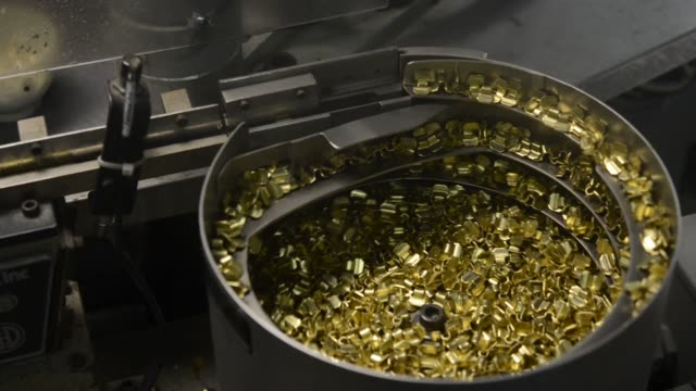 a whistle falls from a conveyor belt into a bit after being soldered at the american whistle corp factory in columbus ohio us a whistle falls from a... - cork material stock videos & royalty-free footage