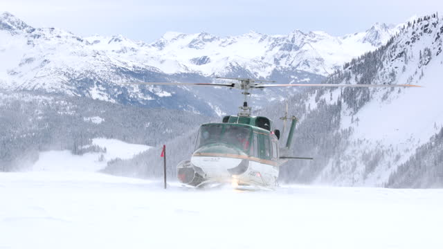 whistler heli-skiing helicopter is getting ready for take-off, in the canadian rockies on february 02, 2017. - ski resort stock videos & royalty-free footage