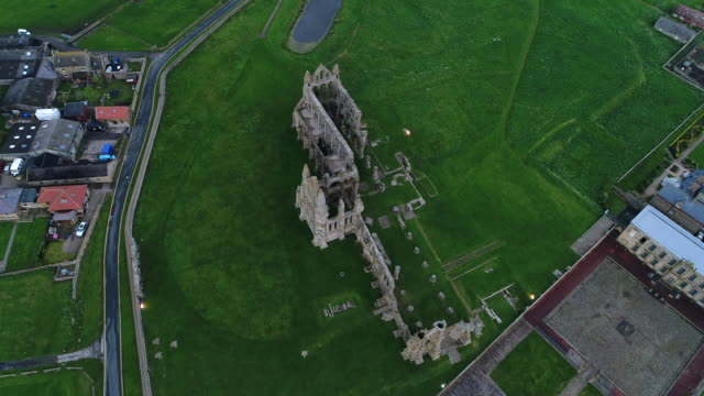 whitby abbey overhead looking down aerial video - whitby north yorkshire england stock videos & royalty-free footage