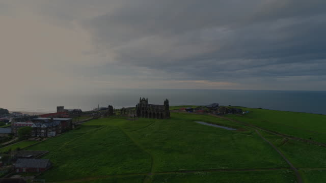 whitby abbey rising shot aerial video - whitby north yorkshire england stock videos & royalty-free footage