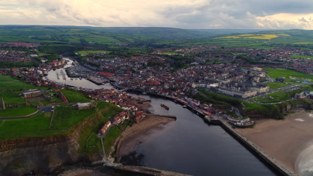 whitby backing away aerial video - whitby north yorkshire england stock videos & royalty-free footage
